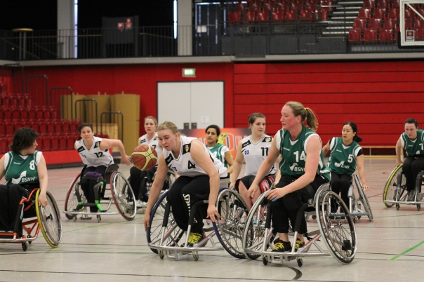 Mareike Adermann wheels past Marina Mohnen for the ball at the German national championships.